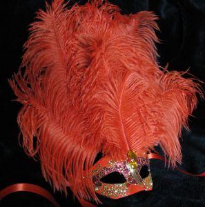 Orange feather venetian masquerade party mask by www.socaldesignco.com